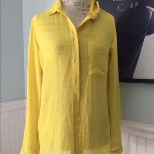 Sheer yellow blouse